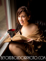 Portland girl by a Winter window with book and coffee